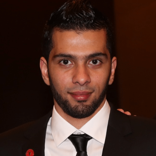 Ahmed Abouelenein in a suit and tie